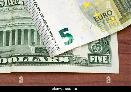 5 US dollars and 5 Euro - Stock Image