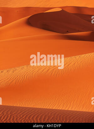Vertical view of lines, curves, shapes, ridges, shadows and textures of red sand dunes in Sossusvlei, Namib Desert, - Stock Image