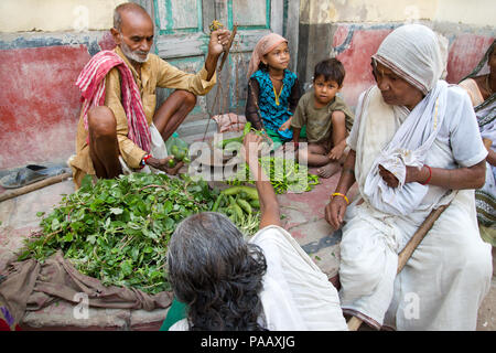 Indian Hindu widows shopping for vegetables in market in Vrindavan , India - Stock Image