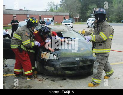 Sandy Hill Fire and Rescue arrives at the scene and begins to assess simulated injuries. They are checking on the victim that flew through the car windshield, played by Pickering High School student Jaquelin Lopez, 16. The demonstration about what can happen when drinking and driving mix took place at Pickering High School March 13. - Stock Image