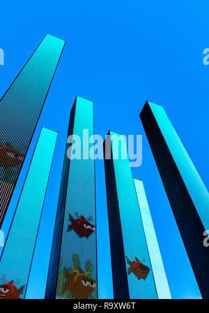 An illuminated artwork against a blue sky. - Stock Image