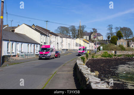 28 March 2019 The ssea wall at the waterfront in Killyleagh village in County Down Northern Ireland on Strangford Lough at low tide. The lough is famo - Stock Image