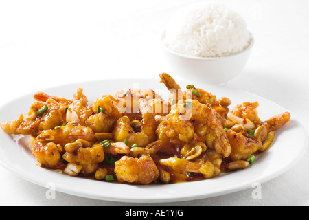 Kung Pao pau shrimp prawn spicy oyster sauce chinese food with green onion dish white plate delicious mouth watering - Stock Image