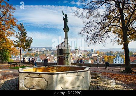 Historic Drinking Fountain in the Lindenhof Hill Park, Zurich, Switzerland - Stock Image