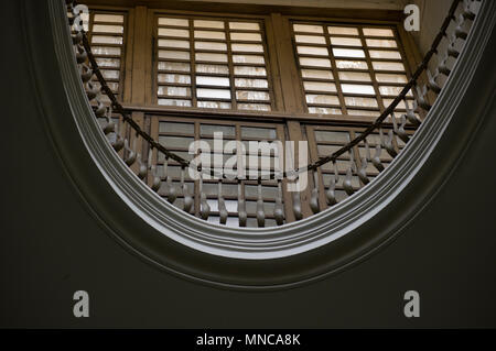 architectural feature of a wooden balcony and slatted windows inside a medieval building in florence italy - Stock Image