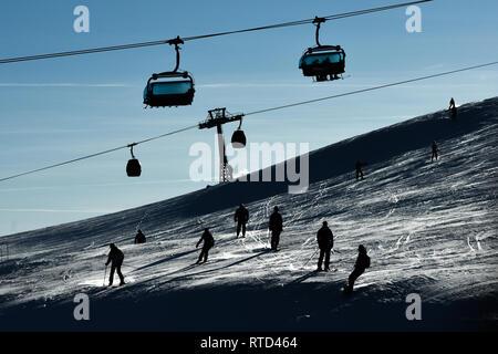 People enjoy skiing at Kronplatz - Plan de Corones ski resort in Alta Badia, the Dolomites, South Tyrol, Italy - Stock Image