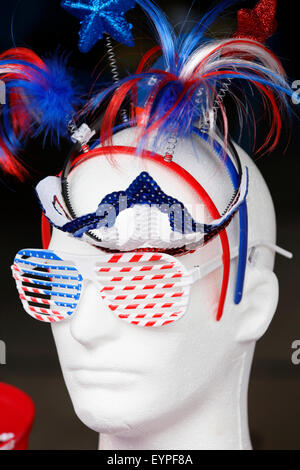 4th of July celebration. Mannequin with Independence day hair accessories, cool shades, and tiara. - Stock Image