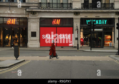 London, UK. 25th Dec, 2018: A pedestrian walks along Regents Street on Christmas day with no public transport running. Some parts of the city experienced dense fog which is expected to linger for the rest of the week. Credit: David mbiyu/Alamy Live News - Stock Image
