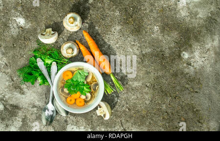 Mushroom soup with vegetables. On rustic background. - Stock Image