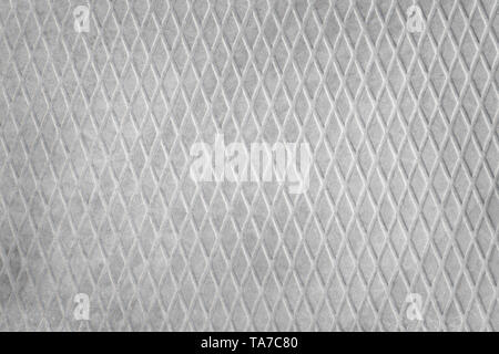 Rough gray concrete slab with diamond pattern close up. Industrial texture and background - Stock Image