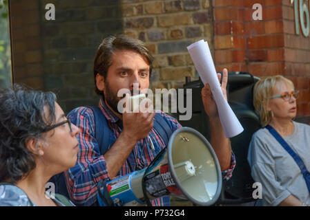 London, UK. 3rd July 2018. One of the traders who will lose his livelihood if the shopping centre is demolished speaks at the protest outside Southwark Council Offices calling on the Council Planning Committee to reject the plans by tax avoiding property giant Delancey and University of the Arts London to demolish the Elephant & Castle Shopping Centre  and replace it with luxury housing and a new building for the London College of Communication. Credit: Peter Marshall/Alamy Live News - Stock Image