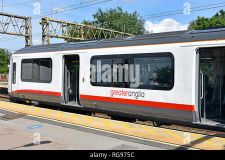 Greater Anglia commuter train with passenger access doors open waiting at platform to leave Shenfield Elizabeth line railway station Essex England UK - Stock Image