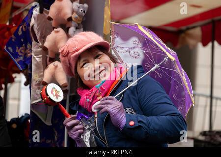 London, UK, 10 February, 2019. Chinese New year celebration at China Town, SOHO, London, UK. Chinese woman selling Chinese toys. Credit: Harishkumar Shah/Alamy Live News - Stock Image