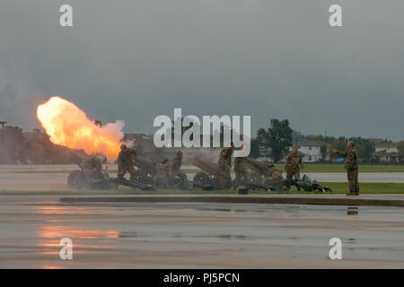 U.S. Army soldiers from the Maneuver Support Center of Excellence, Fort Leonard Wood, Missouri, fire a 17-volley cannon salute to honor outgoing commander U.S. Air Force Gen. Darren W. McDew during the U.S. Transportation Command change of command ceremony, Aug. 24, 2018, at Scott Air Force Base, Illinois. McDew relinquished command to U.S. Army Gen. Stephen R. Lyons. (U.S. Air Force photo by Tech. Sgt. Paul Villanueva II) - Stock Image