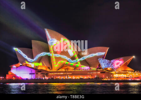 Sydney, Australia - 25 May, 2018: Sydney city landmark - Sydney Opera House at harbour waterfront during annual light show of music, light and ideas p - Stock Image