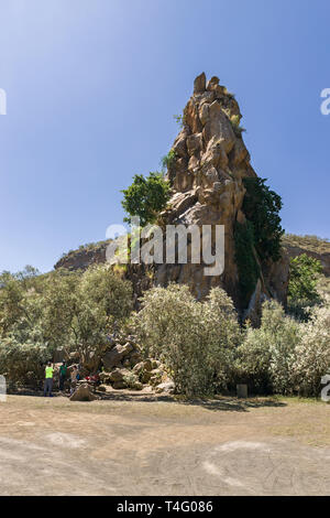 Fischers Tower with climbers at the base getting ready, Hells Gate National Park, Kenya - Stock Image