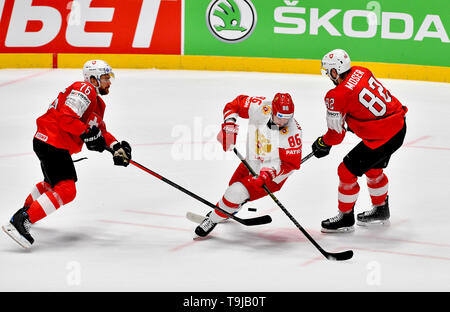 Bratislava, Slovakia. 19th May, 2019. L-R Joel Genazzi (SUI), Nikita Kucherov (RUS) and Simon Moser (SUI) in action during the match between Switzerland and Russia within the 2019 IIHF World Championship in Bratislava, Slovakia, on May 19, 2019. Credit: Vit Simanek/CTK Photo/Alamy Live News - Stock Image