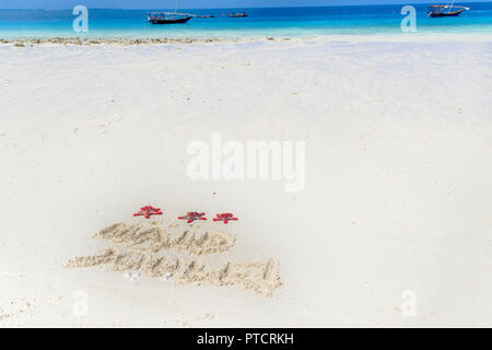 merry christmas written in Estonian on the sand, zanzibar , nungwi paradise beach, africa - Stock Image