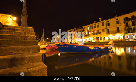 Historic harbour in the night - Stock Image