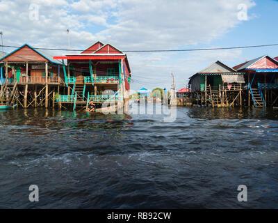 Stilted homes in Kampong Phluk floating village on Kampong Phluk RiverSiem Reap Cambodia Asia home to approximately 3000 predominately Khmer fishing p - Stock Image
