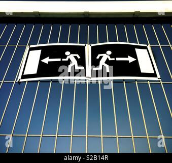 Two exit signs - Stock Image