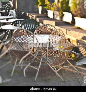 Chairs Leaning Up Against a Table - Stock Image