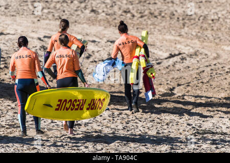 NSLSC members of a Surf Rescue training session on Fistral Beach in Newquay in Cornwall. - Stock Image