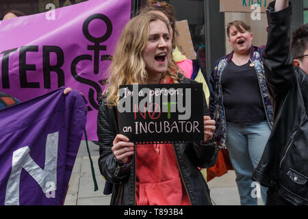 London, UK. May 11th 2019. Feminists for Arbortion Rights stand beside the route of the anti-choice, US-inspired 'March for Life' taking place today., making clear their support for  reproductive rights and the decriminalisation of abortion. They say the March for Life is made up of extreme anti-women, anti-choice, evangelical groups which regularly harass women outside abortion clinics, with links to homophobic, fascist and far-right organisations and opposes contraception, sex education and IVF treatment. Peter Marshall/Alamy Live News - Stock Image