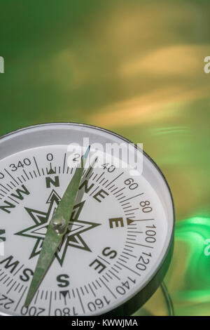 Macro-photo of compass rose face with needle - with copy space. - Stock Image