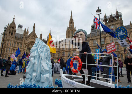 London, United Kingdom. 15 January 2019. A 1.3m high ship dubbed HMS Brexit sits outside the Houses of Parliament with Theresa May clutching a People's Vote life ring at the bow, ahead of Tuesday's Brexit vote. The action is part of Best for Britain's joint campaign with Avaaz and Hope Not Hate calling on MPs to support a final say for the public on Brexit. Credit: Peter Manning/Alamy Live News - Stock Image