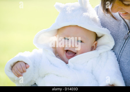 portrait of baby with mother - Stock Image