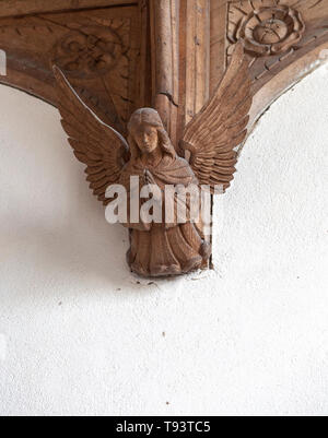 Carved wooden angel figure church of Ilketshall St Andrew, Suffolk, England, UK - Stock Image