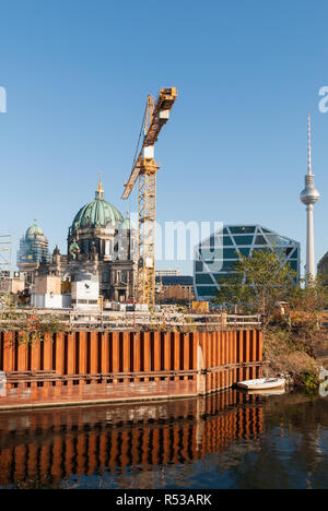 Construction across the canal from the Berlin Cathedral - Stock Image