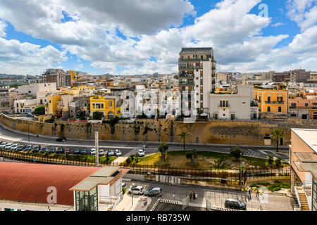 A view from a cruise ship leaving the harbor of the coastal port city of Brindisi, in the Puglia region of Italy. - Stock Image