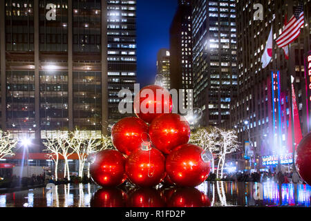 Giant Christmas Ornaments in Rockefeller Center are one of the highlights of the Holiday Season in New York City. - Stock Image