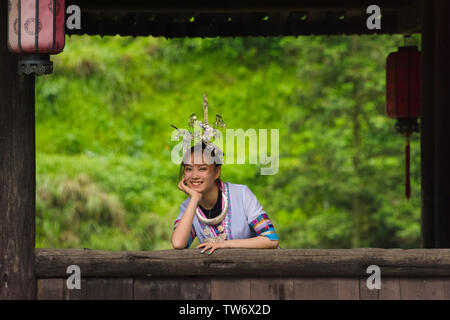 Dong girl in traditional clothing, Hunan Province, China - Stock Image