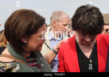 Sinn Fein Leader Mary Lou McDonald (left) with DUP leader Arlene Foster (right) at a vigil in Londonderry, Northern Ireland, following the death of 29-year-old journalist Lyra McKee last night after guns were fired and petrol bombs were thrown in what police are treating as a 'terrorist incident'. - Stock Image