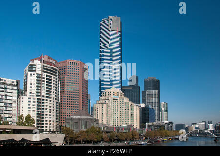 The 297-metre Eureka Tower skyscraper looms above the Southbank precinct along the Yarra River in Melbourne, Australia - Stock Image