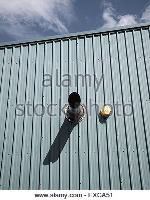 Air vent and burglar alarm on side of building on industrial estate.  Photographed in the West Midlands - Stock Image