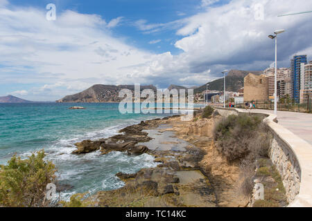Calp Spain seafront promenade paseo with mountain views and hotels and apartments on the Spanish Mediterranean coast - Stock Image