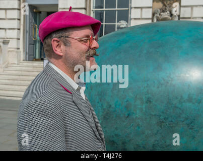 London, UK. 17th April, 2019. A giant bronze egg sculpture, 'Oeuvre', by Gavin Turk (pictured), is unveiled at Somerset House. The bronze egg is intended as a starting point and inspiration for photographers around the world to Collaborate with Gavin on an ambitious public installation for Photo London, titled 'Gavin Turk - Portrait of an Egg'. All that is required to take part is a digital photographic device with which to record their own 'Portrait of an Egg. Credit: Malcolm Park/Alamy Live News. - Stock Image