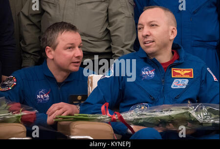 Expedition 53 Commander Randy Bresnik of NASA, right, listens as NASA Interpreter Evgeny Sokol talks during a Karaganda - Stock Image
