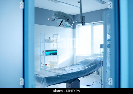 operating room and surgical lamp in a modern clinic - Stock Image
