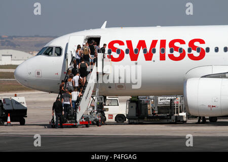 Passengers boarding a Swiss International Air Lines Airbus A320 jet plane before departure. Commercial air travel. - Stock Image