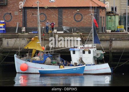 Fishermen on the SD395 Aurora Fishing coble, next to another fishing boat. River Wear,Sunderland. - Stock Image