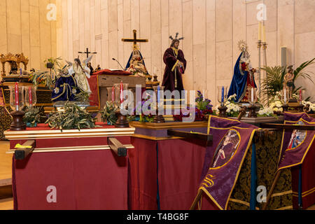 Miniature models of Christ in various stages of of the Passion story which are paraded through the streets in the Pasión de Los Niños, Passion of the  - Stock Image