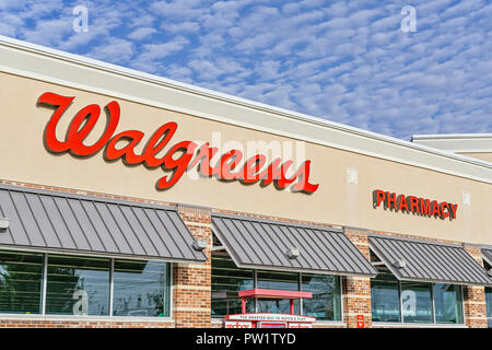 Walgreens Pharmacy front exterior sign and corporate logo in Montgomery, Alabama USA. - Stock Image