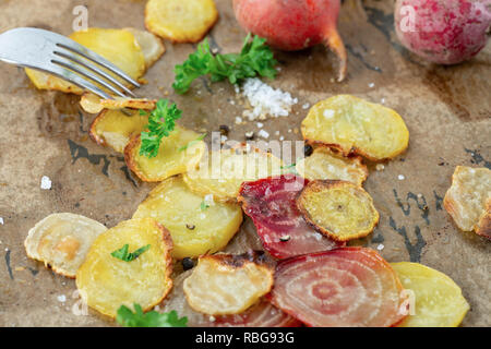 Organic oven baked, sweet and juicy sliced yellow beet and polka beet, baked in olive oil and served with parsley and sea salt. - Stock Image