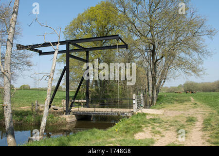 Northlands Lift Bridge, over the disused Wey and Arun Junction Canal, Sussex, UK. April - Stock Image
