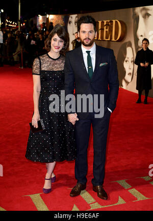 Lizzy Caplan and Tom Riley attending the 'Allied' UK Premiere at Odeon Leicester Square, London. - Stock Image
